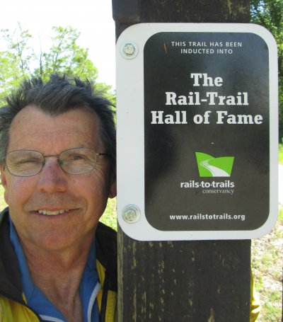 Jim-Schmid-next-to-Hall-of-Fame-sign-Trail-of-the-Coeur-d'Alenes-ID-5-12-2016