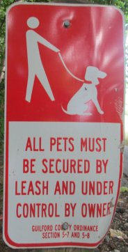 All_pets_must_be_secured_by_leash_sign_Greensboro_NC_RT_System_2015_07_06