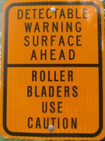 Detectable-warning-surface-ahead-sign-Pere-Marquette-MI-2015-09-06