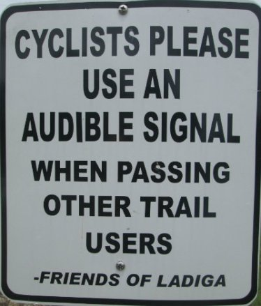 Cyclists_please_use_an_audible_signal_when_passing_other_trail_users_sign_Chief-Ladiga-Trail-AL-2015-06-01