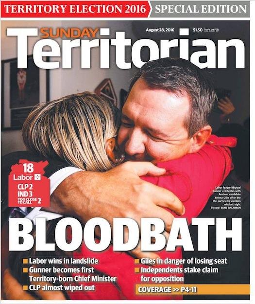 นสพ. Sunday Territorian ฉบับ 28 ส.ค. 2016 พาดหัวข่าวการฆาตกรรมหมู่ (ทางการเมือง) เลเบอร์ชนะเลือกตั้งแบบแผ่นดินถล่ม นาย Michael Gunner (คนในภาพ) ได้ขึ้นเป็นผู้นำรัฐบาล NT คนใหม่