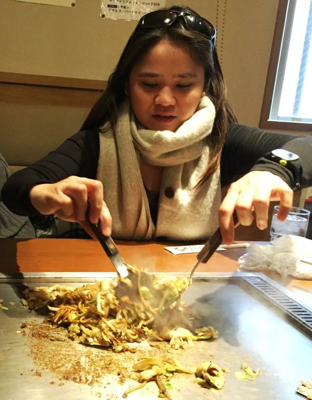 Babe stir-frying the Yakisoba :D