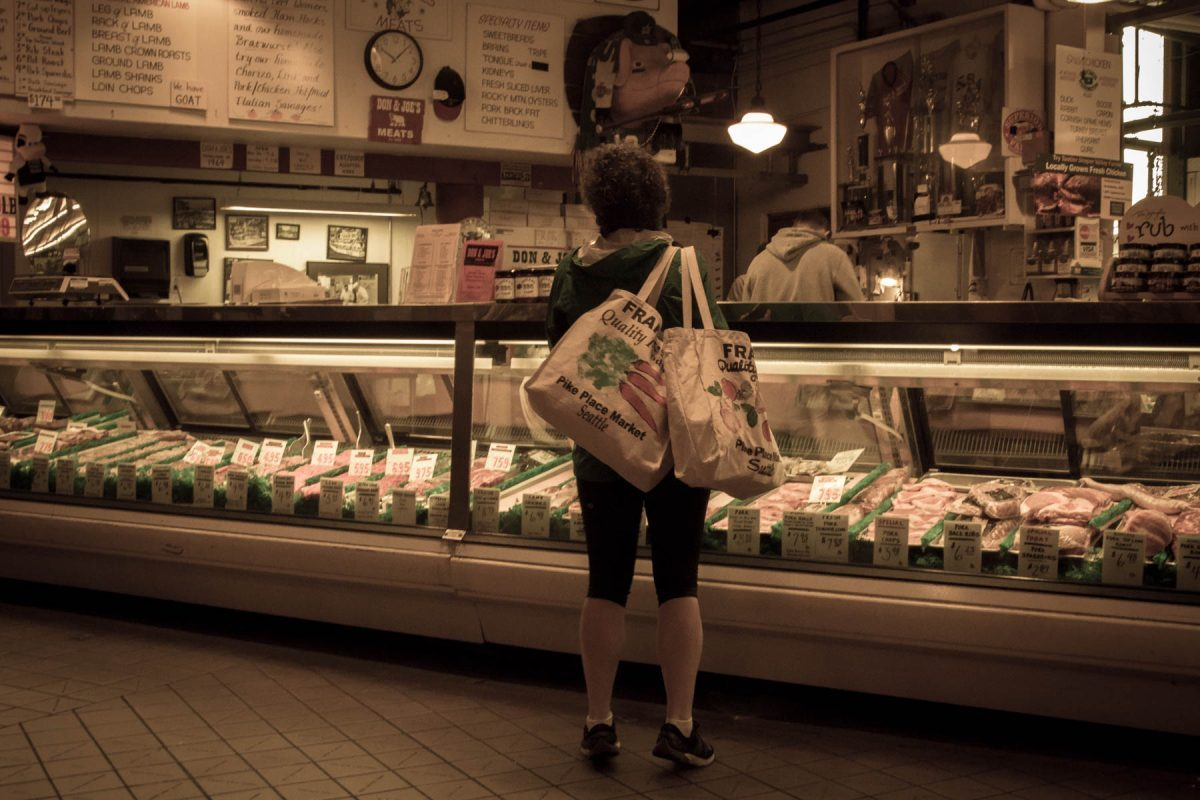 Shopping in Pikes Market by Jim Berger