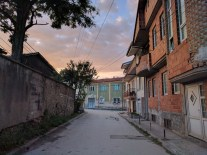 Bitola at dusk. Note the architecture of new houses. We always know they are new because they are not finished.