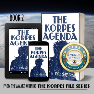 "Book covers of ""The Korpes Agenda"" - book 2 in digital and paperback formats with the CYGNUS semifinalist badge on it. Winner yet to be announced."