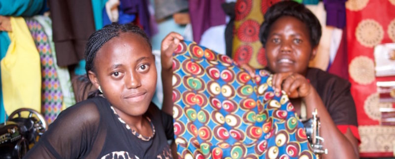 Dorcas shows off a dress she made at her tailoring attachment.