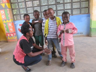 Program Manager, Elizabeth Nzivo, prepares some of our youngest students for their check-ups.