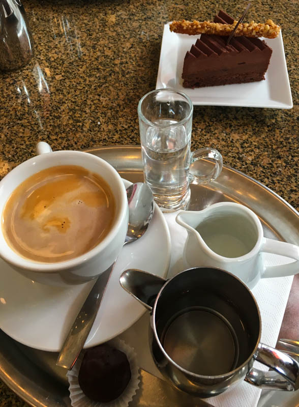 Chocolate cake and coffee in the Cafe Imperial, Prague