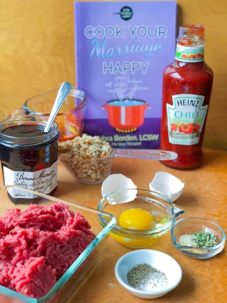 All ingredients for Life Is Sweet and Sour Meatballs along with the cookbook, Cook Your Marriage Happy