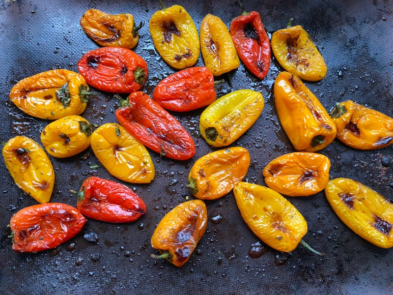 Roasted Mini Peppers on a baking pan, cooked