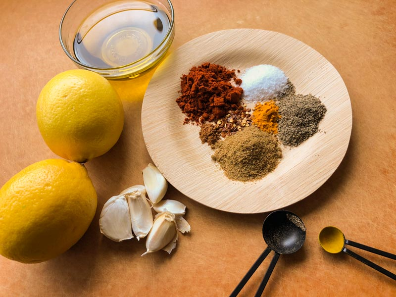 oven-roasted chicken shawarma: Ingredients to marinate chicken and onions, spices, lemons, garlic, olive oil