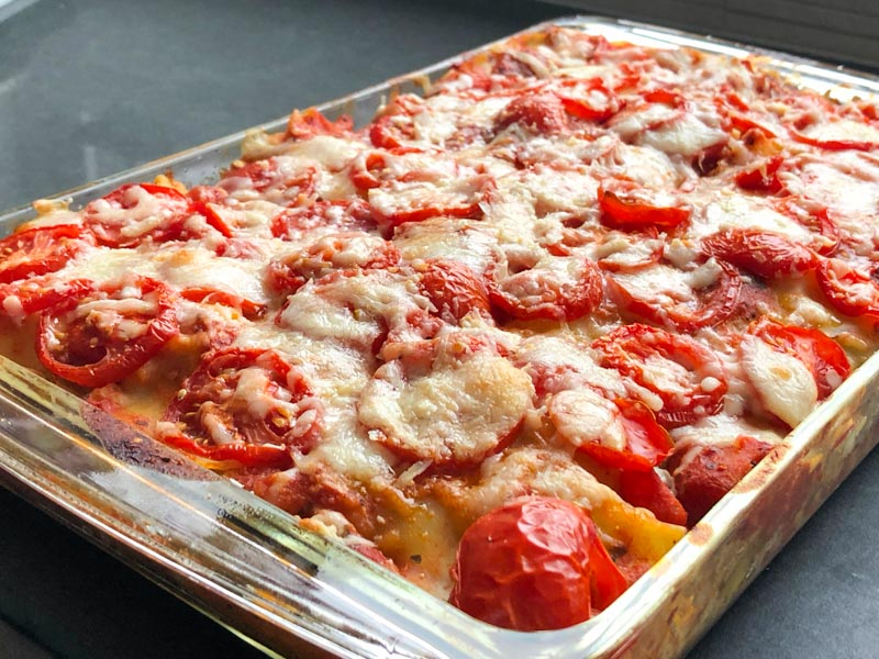 Roasted Veggie Lasagna cooked in a glass lasagna dish close up