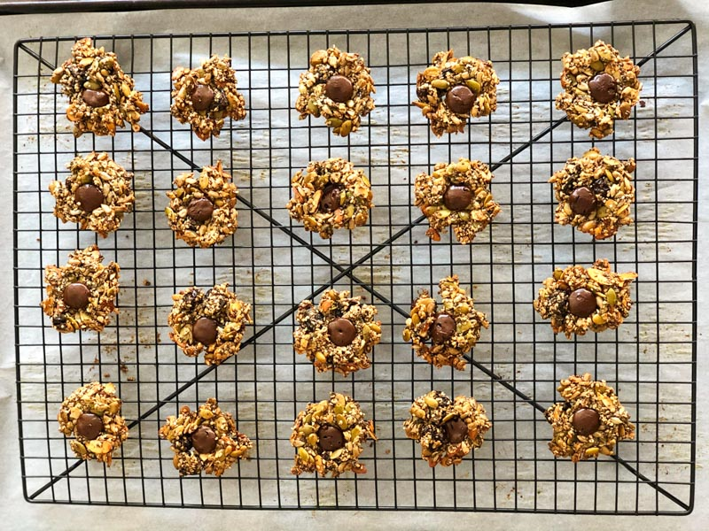 Seed Power Cookie cooling on a wire rack on top of parchment paper