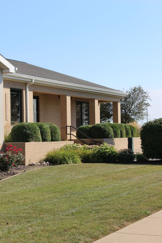 Large boxwoods in planters at Goodfield location
