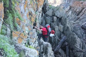 Paul climbing up rocks
