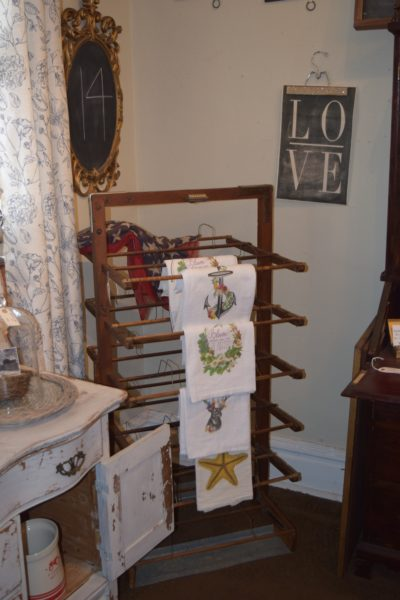 We liked the antique hat rack in this shop that was used for linens.
