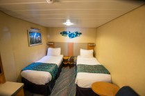 An inside stateroom set up with twin beds