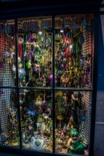 Inside a window FULL of Mardi Gras memorabilia.