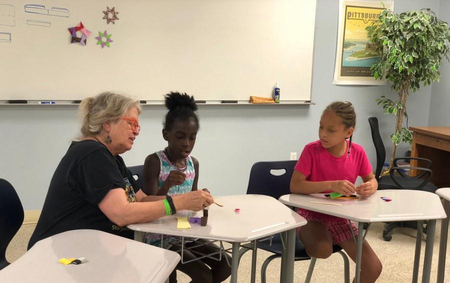Megan Hicks teaching origami class