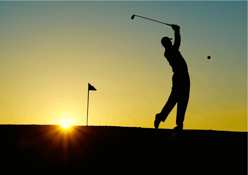 silhouette of man playing golf during sunset