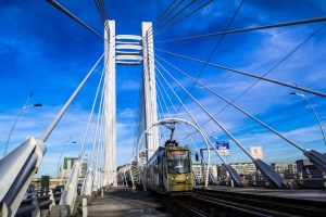 bridge with train under blue sky
