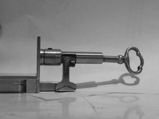 A view of the key in the lock end of the main box latch.