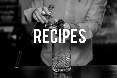 Bartender making alcoholic cocktail , metal jigger and bar environment