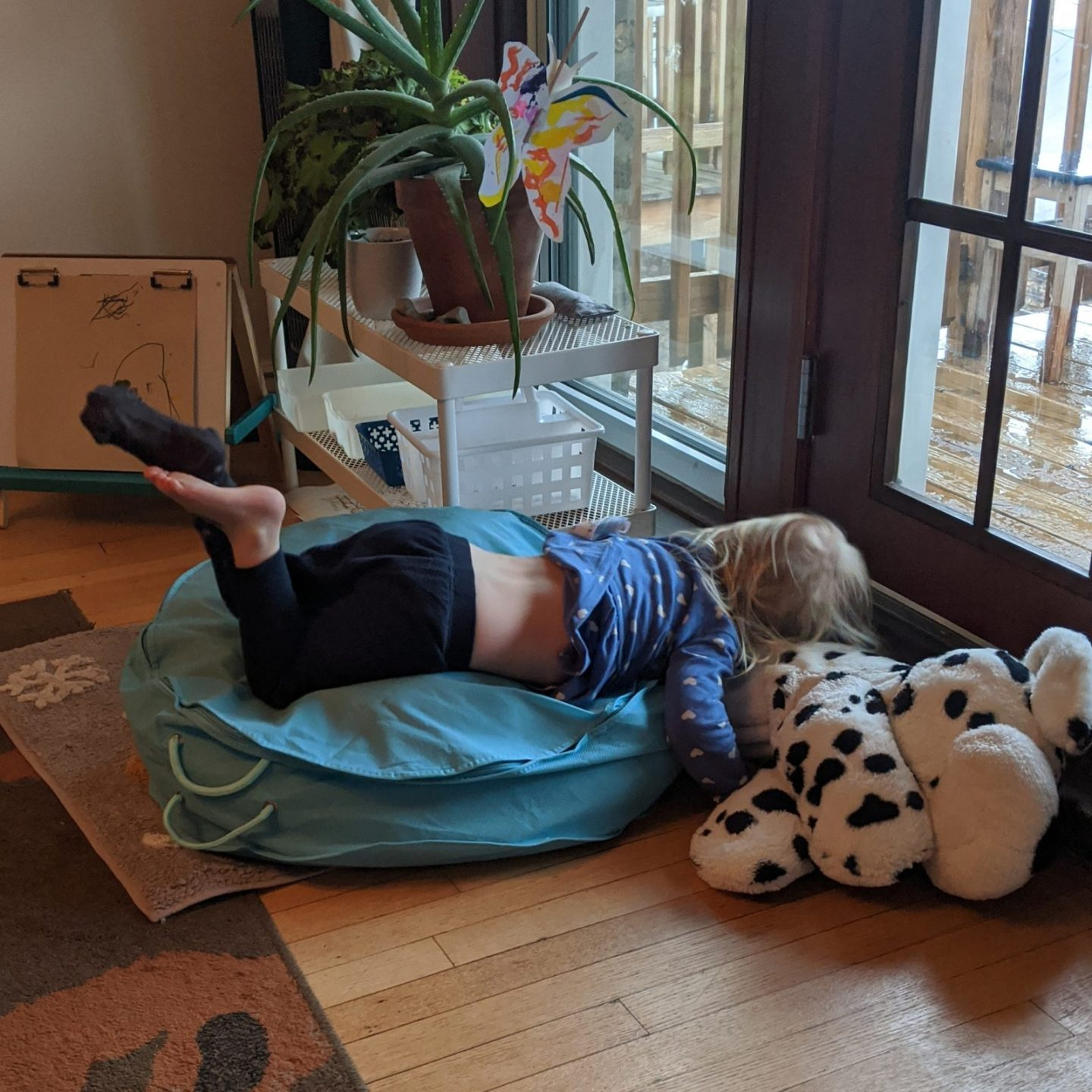 child diving face-first onto floor pillow