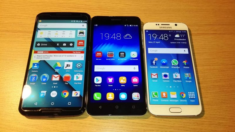 Size matters: The Honor 4X beside the Nexus 6 (left) and Galaxy S6 (right)
