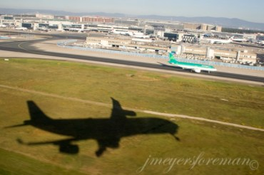shadow of jet taking off from airport