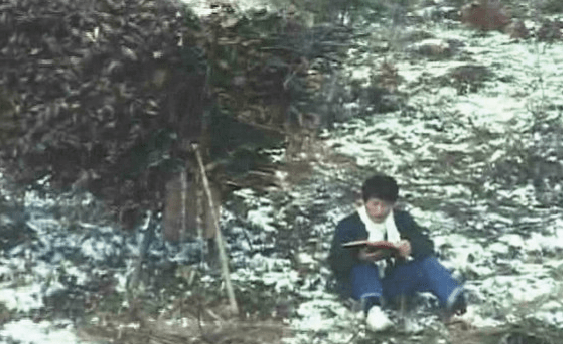 Jeong Myeong Seok reading the bible in the mountains during winter