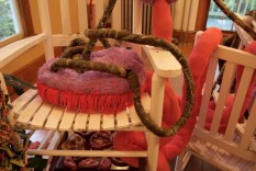Another sculpture rests on this rocking chair.