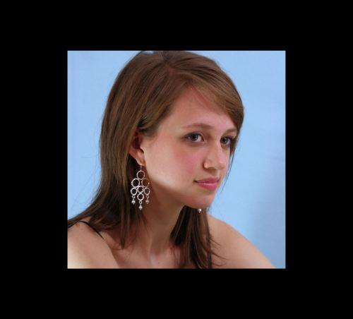 Photo of Gypsy Circle Chandelier Earrings on Model, Ann