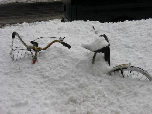 Photo of bike buried in the snow, taken by Joana Miranda