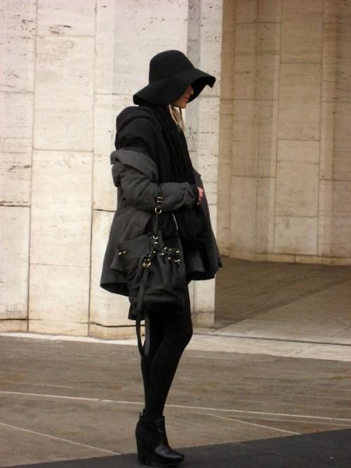 Model posing outside Lincoln Center in black hat, photo taken by Joana Miranda