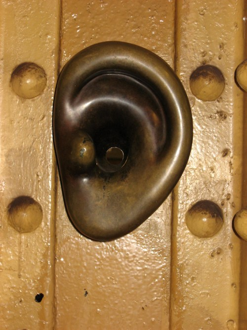 Photo of bronze ear on wall at 14th St. subway station in NYC, taken by Joana Miranda