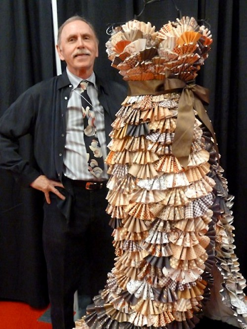 Photo of Tom with paper dress on mannequin