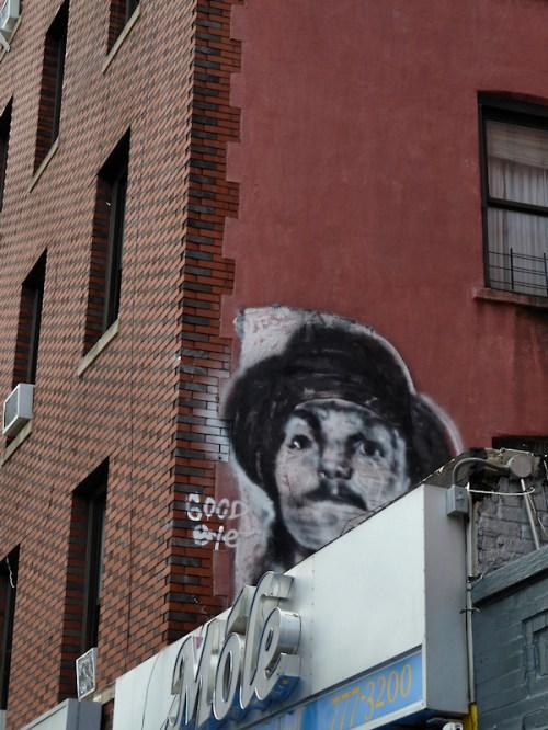Photo of graffiti face on Chinatown wall, taken by Joana Miranda