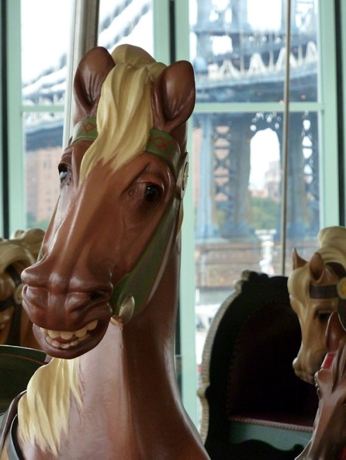 Photo of brown carved carousel horse, taken by Joana Miranda