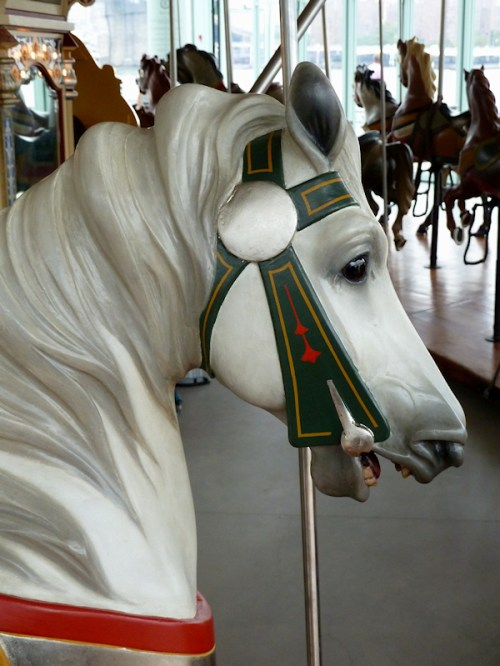Photo of grey carved carousel horse, taken by Joana Miranda