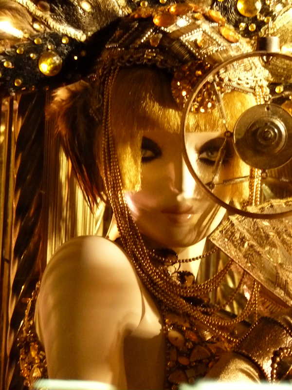 Photo of mannequin all dressed in gold in 2011 Bergdorf Goodman Christmas window display, taken by Joana Miranda