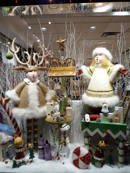 Photo of two caroling dolls in Christmas display window on Broadway, taken by Joana Miranda