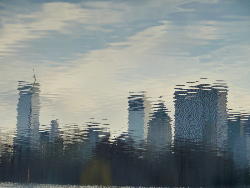 Photo of NY City skyline reflected in the water, taken by Joana Miranda