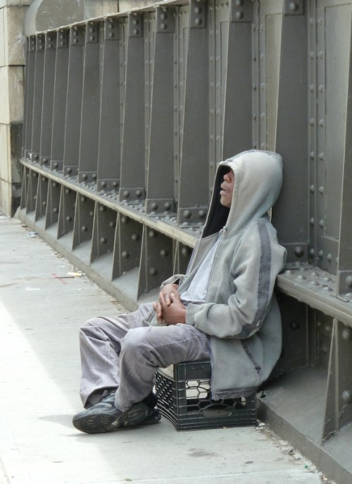 Photo of African American man asleep on a crate, taken by Joana Miranda