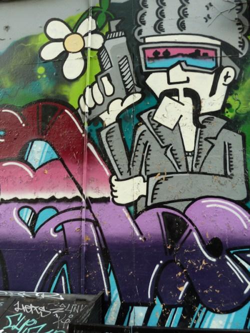 Photo of pacifistic graffiti on wall in Brooklyn, NY, taken by Joana Miranda