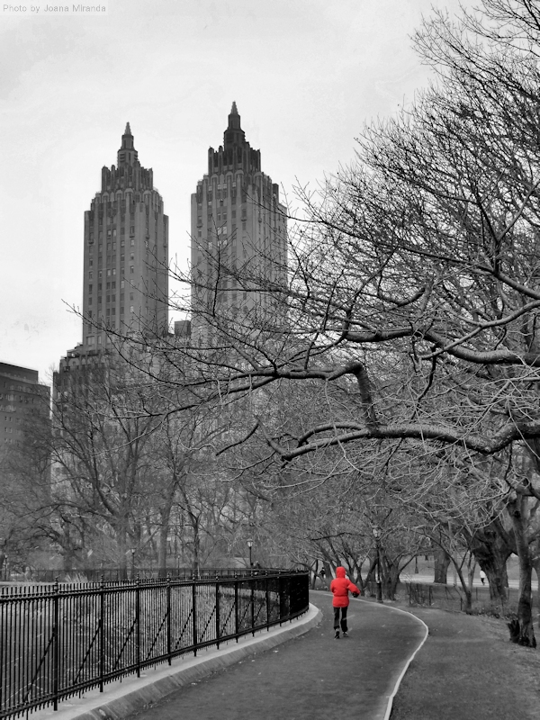 Photo of red hooded pedestrian out walking on the Jacqueline Onassis reservoir