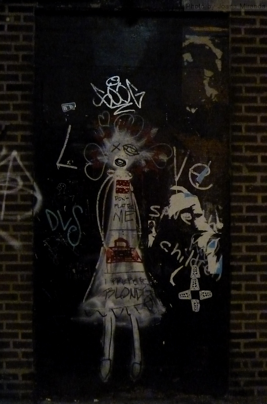 Photo of scary girl graffiti on wall in the Village