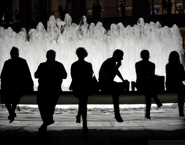 Photo of patrons of the arts sitting at the Lincoln Center Fountain in New York City, taken by Joana Miranda
