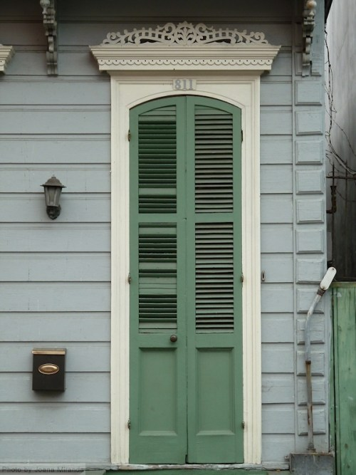 Green door with shutters in New Orleans