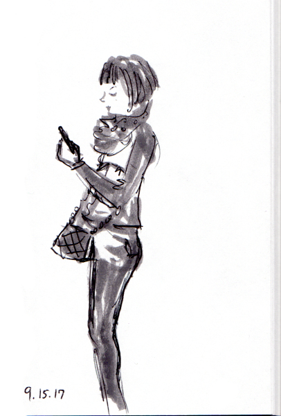 Girl with bob checking her cell phone